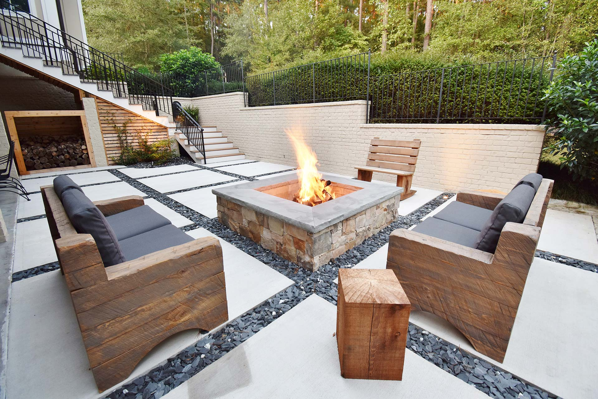 Custom fire pit with concrete squares patio
